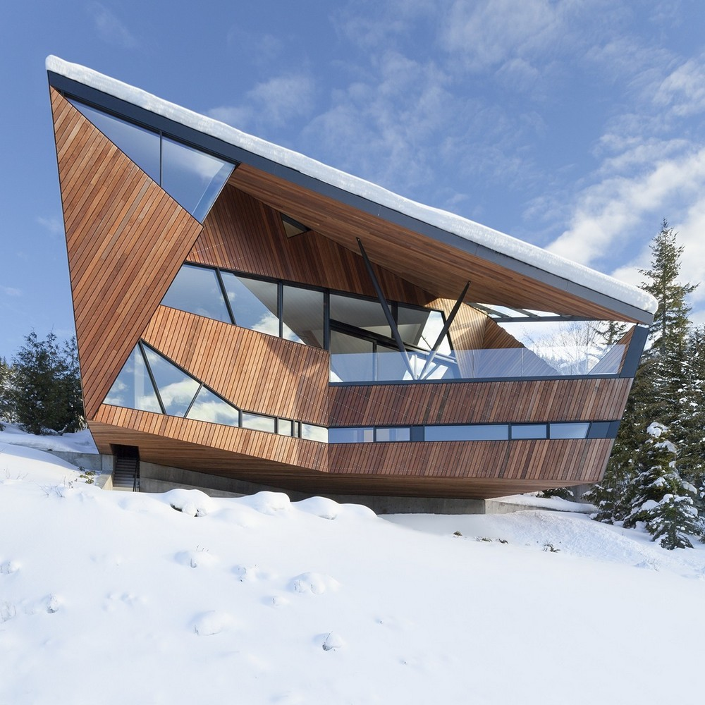 Angled Wood cladding makes up the facade of this country home in Canada.