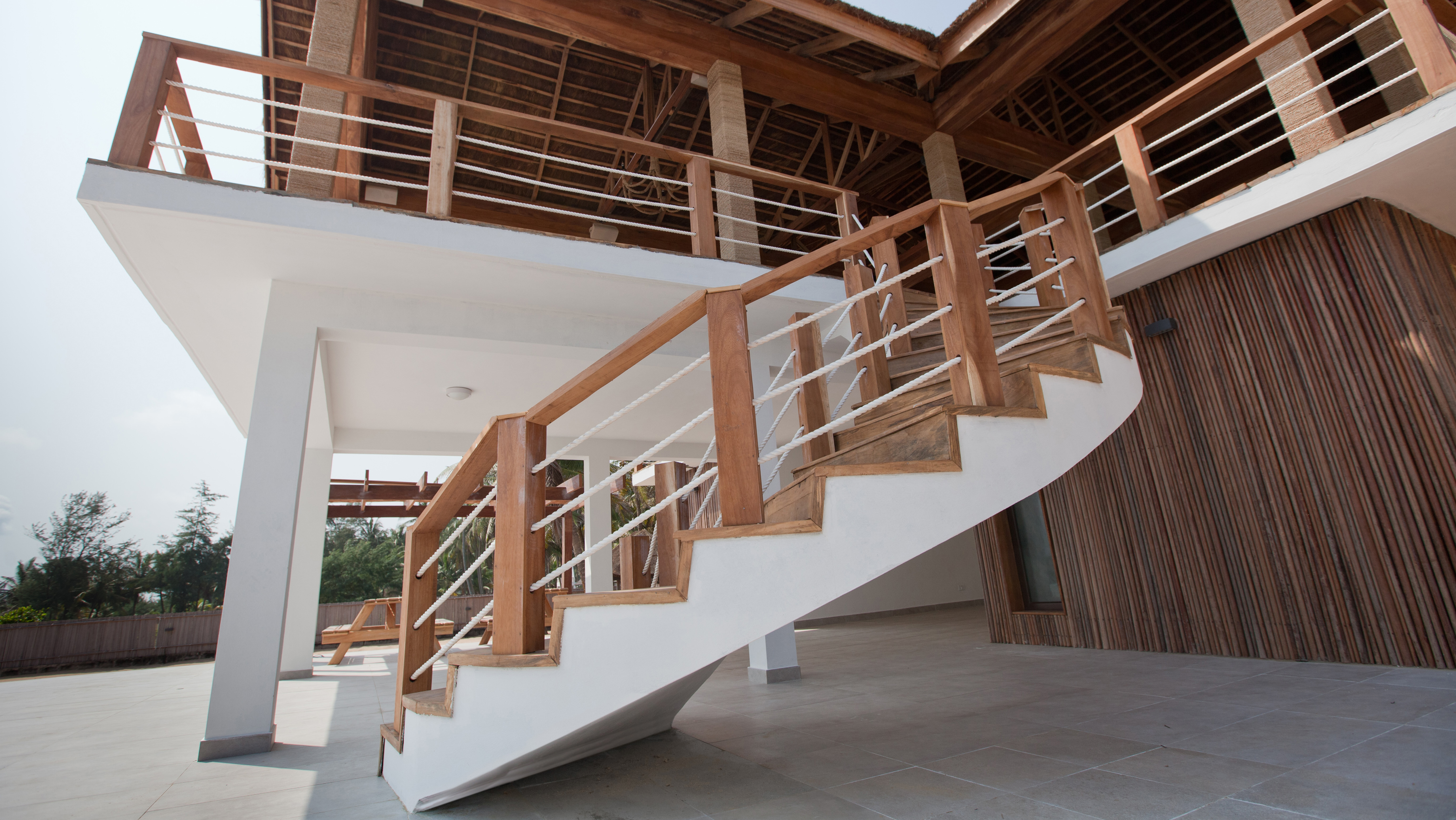 A White and Wood Spiral Staircase in the Kamp Ikaare Beach Resort in Lagos by CMD+A.