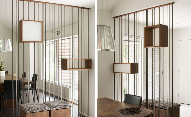 METAL RODS AND WOOD BOXES MAKE UP THIS STYLISH ROOM