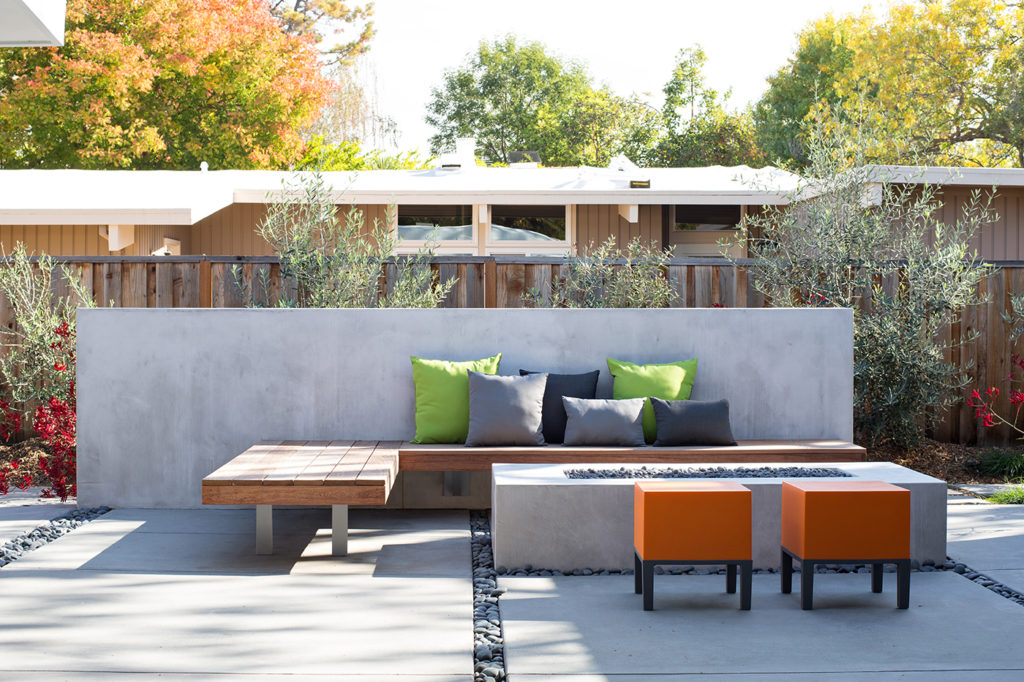 Neutral and Accent colour outdoor pillows in this garden area of an Eichler Remodel by Klopf Architecture