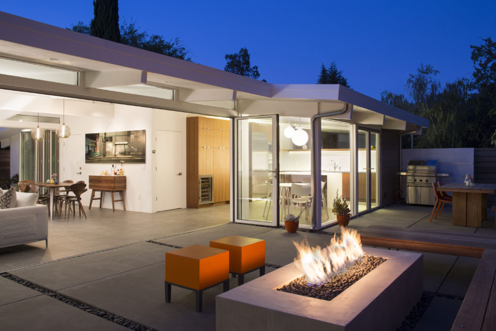 A simple fire pit in this garden area of an Eichler Remodel by Klopf Architecture