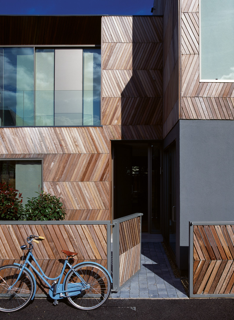 Herringbone style wood cladding for a family home in London.