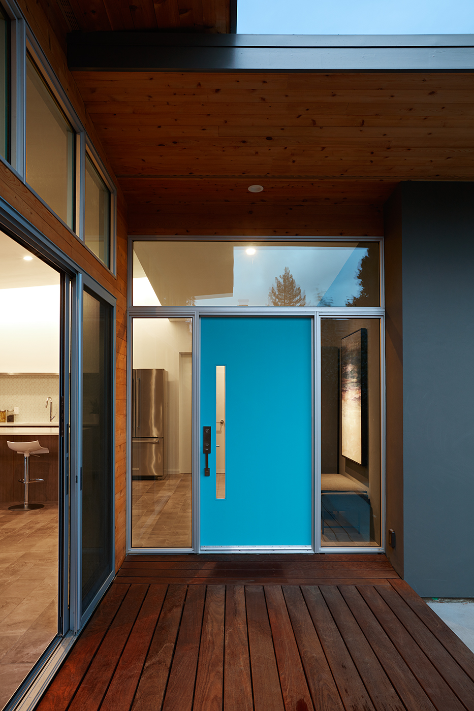 A Bright Blue Front Door for this Mid Century Modern Home Remodel in California by Klopf Architecture