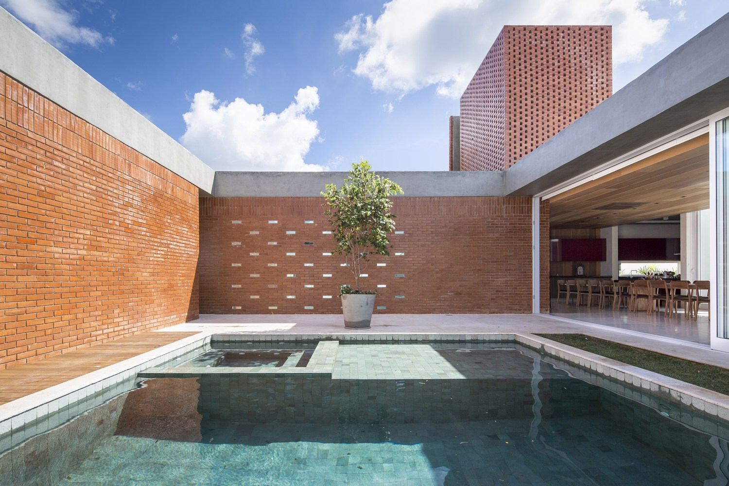 Though composed of solid bricks, this courtyard home in Brazil, gives an idea of stone or brick veneer can offer.