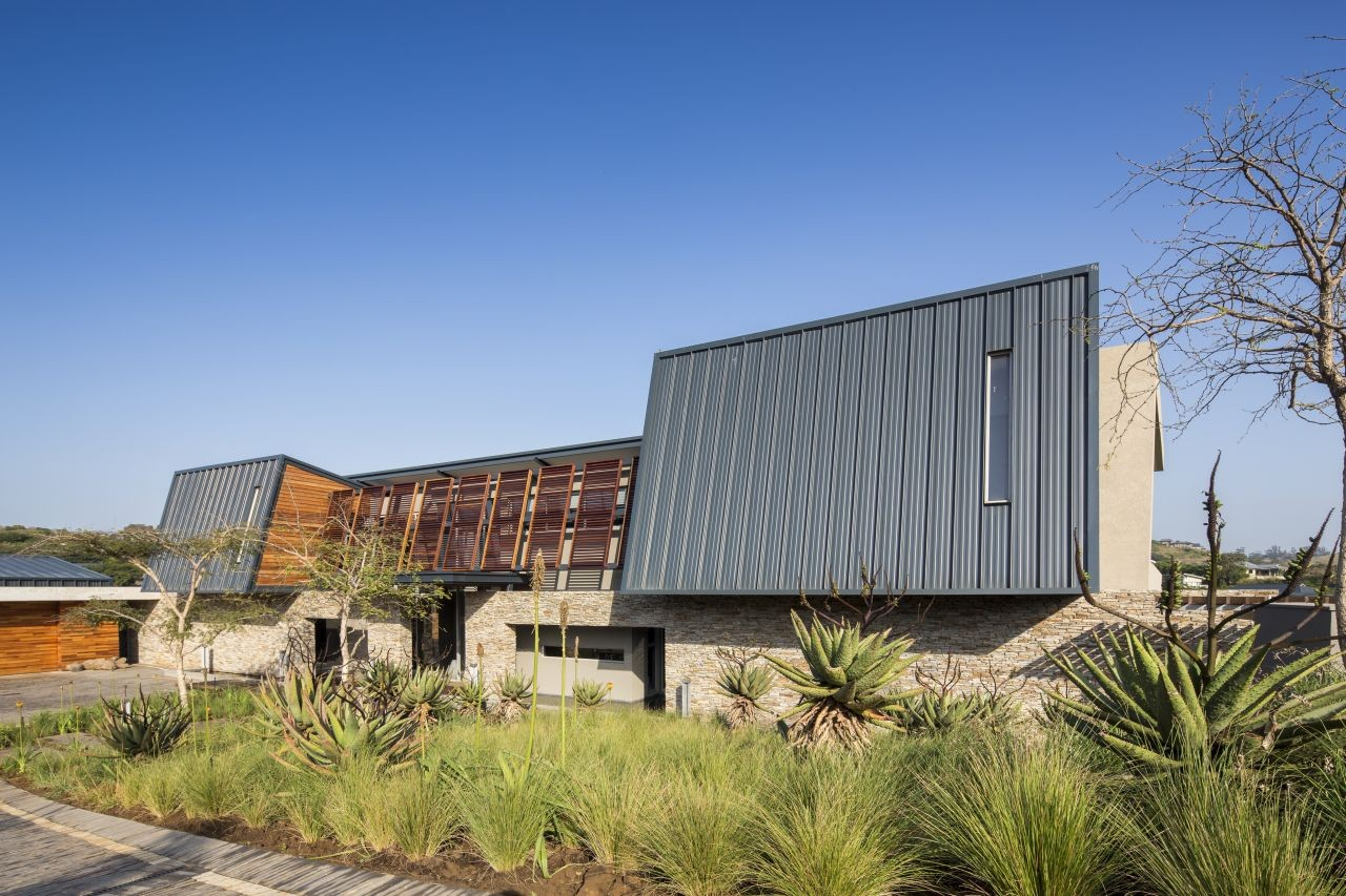 A distinctive metal roof for a large family home in South Africa.