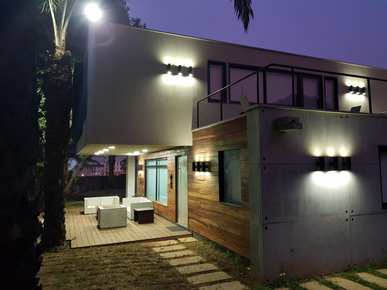 A residential project in Abuja built using shipping containers features an array of outdoor lighting.