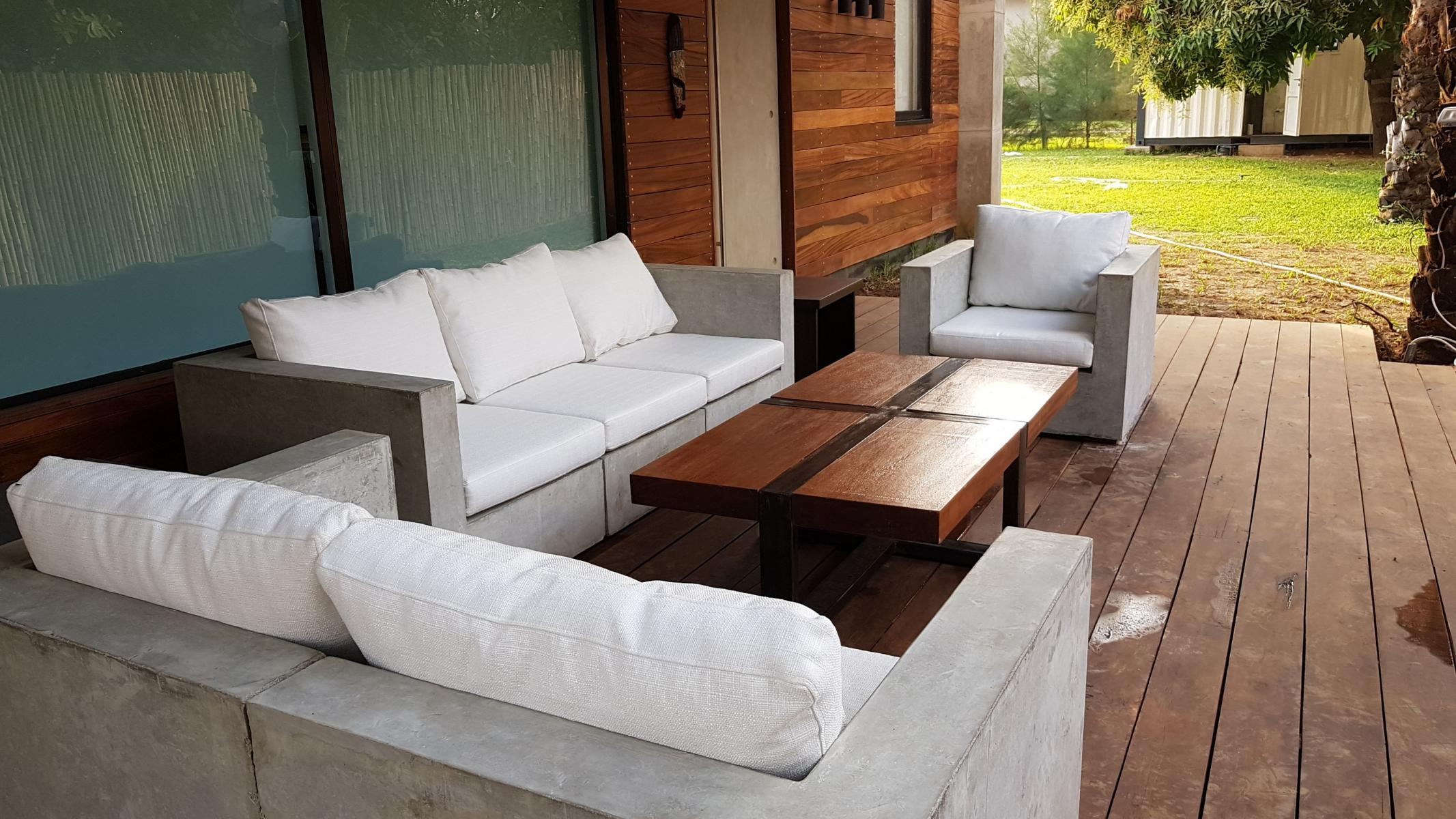 A residential project in Abuja built using shipping containers features an outdoor seating area.