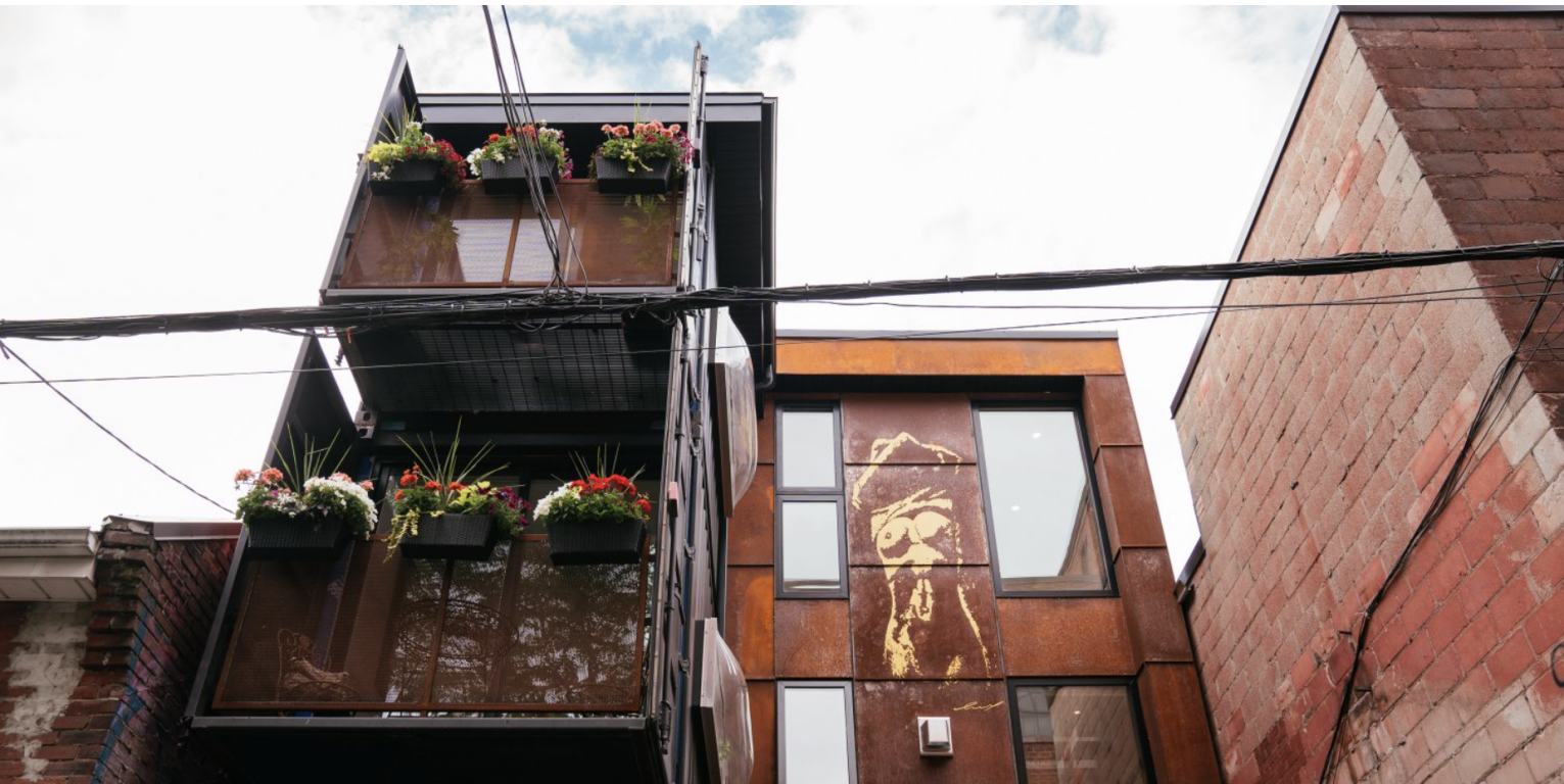 This container home in Toronto features 2 planted terraces.