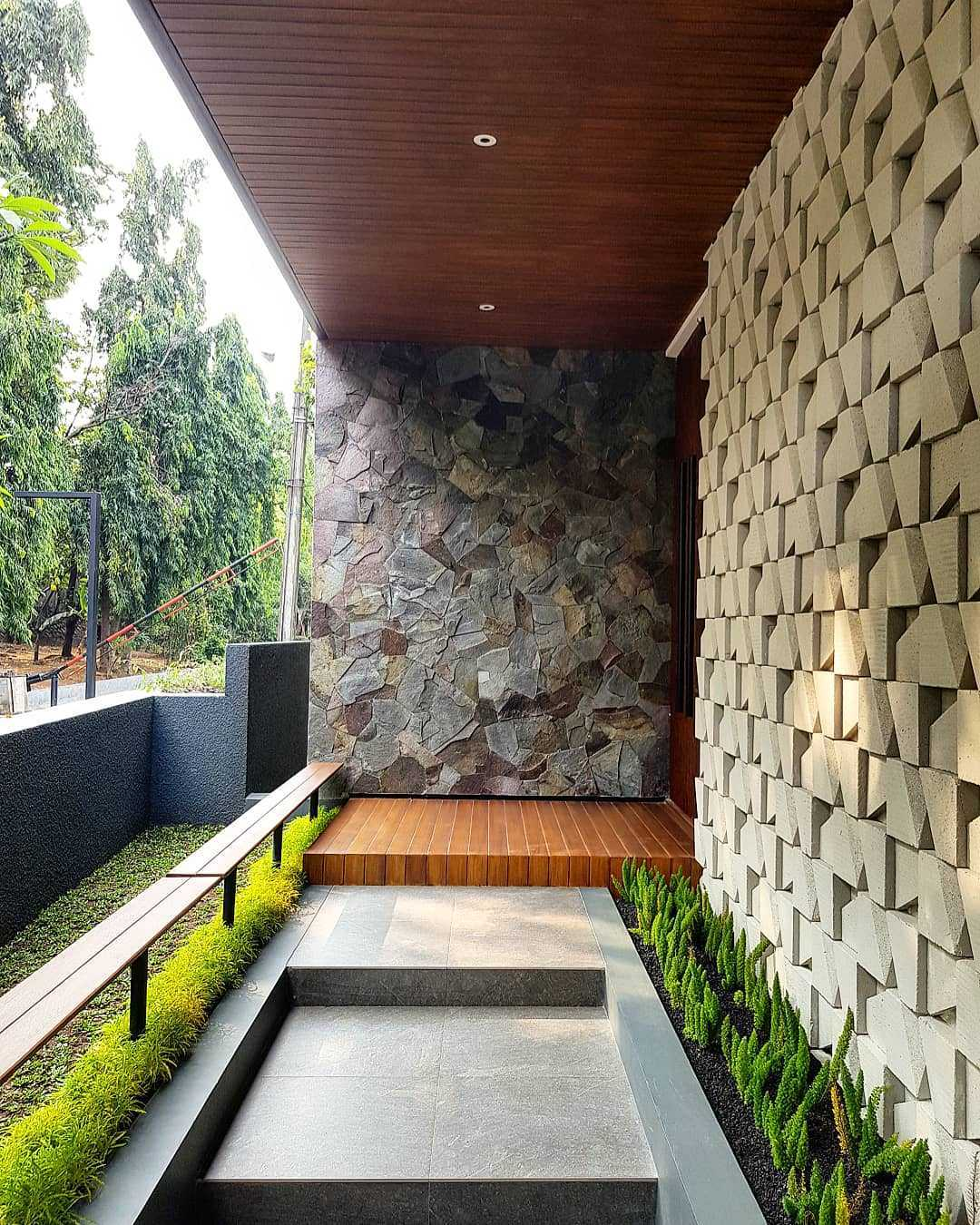 A variety of materials are used to give interest to the walls in this home in Indonesia.