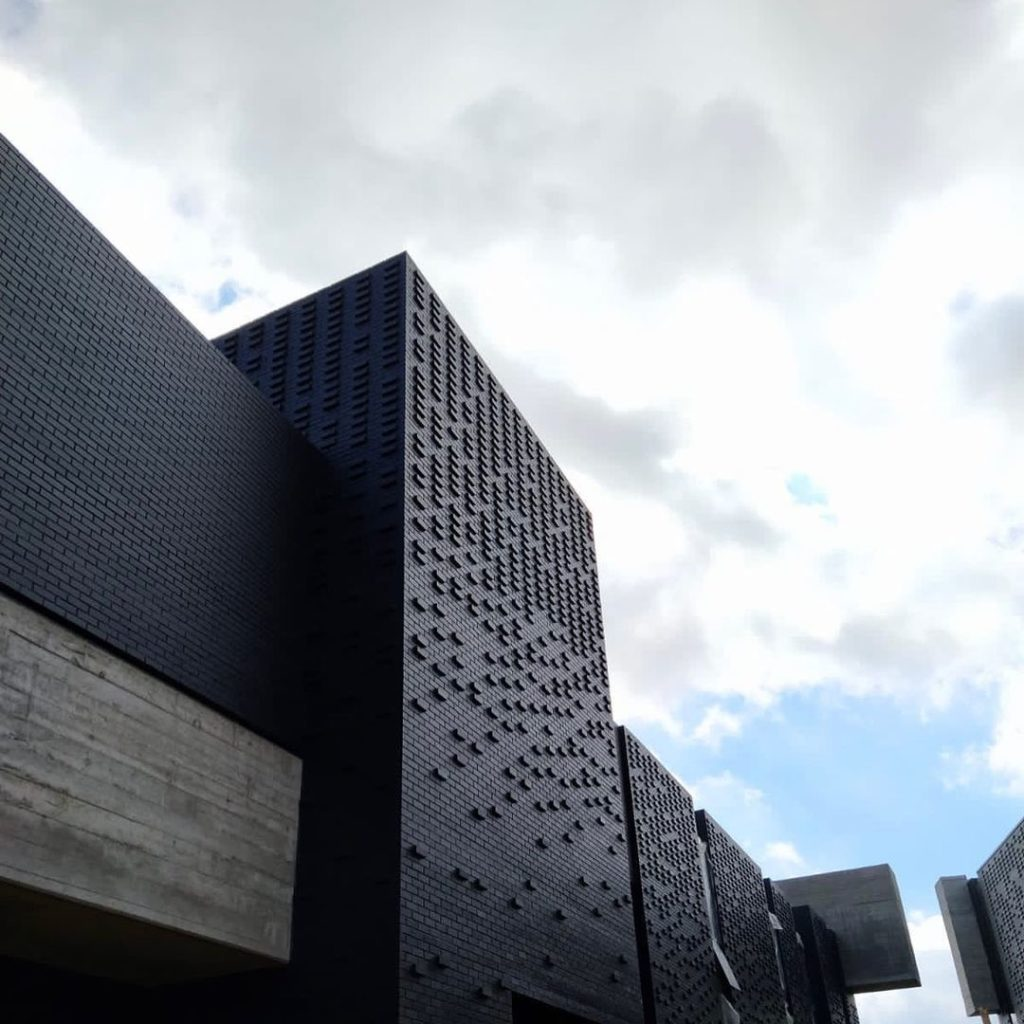 Another view of 31 commerce black brick facade